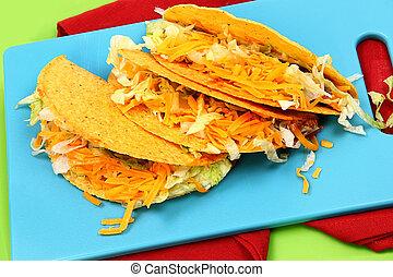 Three American Style Beef Tacos on Cutting Board