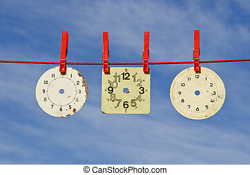 three ancient clock dial on red string