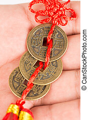 Three ancient Feng shui metal lucky coins on the hand