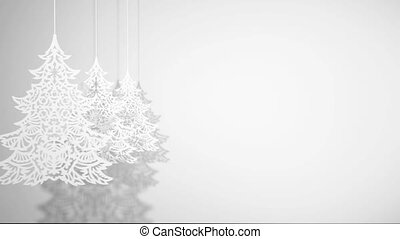 Three animated Christmas trees paper decorations swinging on white background (space for text)