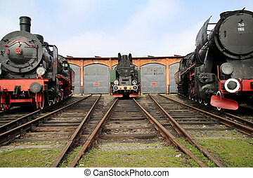 Three antique locomitives in the railway station