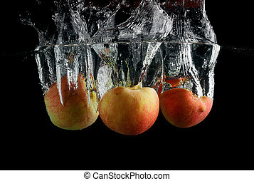 Three apples in water
