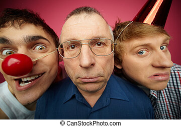 Three april fools looking at camera with different facial...