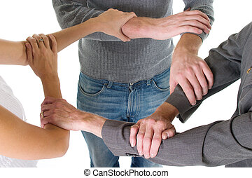 Three Arms Interlocked - Three person business team with...