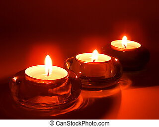 Three aroma candles in glass candlesticks - Three aromatic...