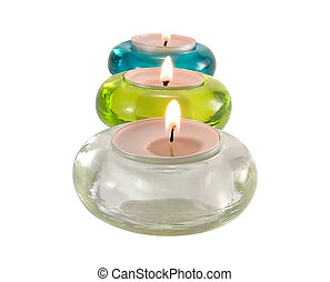 Three aromatic candles in glass candlesticks for relaxation