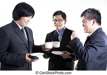 Three Asian business man with coffee break having conversation