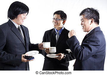 Three Asian business man with coffee break having conversation