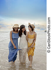 three asian younger woman relaxing happiness emotion on vacation beach