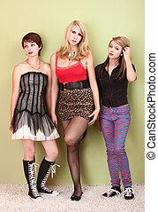Three attractive teen punk girls looking bored