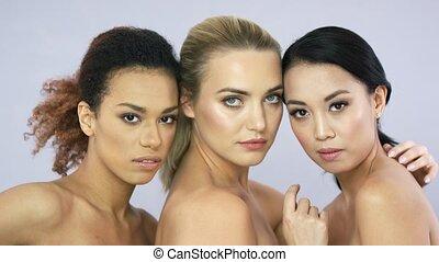 Three attractive women in studio