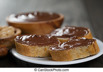 three baguette slices with chocolate hazelnut spread