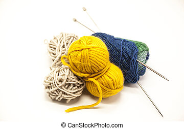 Three ball of woolen threads, yellow, blue, beige and steel ...