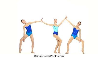 Three ballet girls posing  together