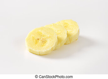 banana slices - three banana slices on white background