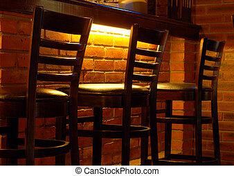 three bar stools in a row