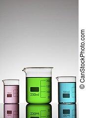 beakers - three beakers with colored liquid bright white...