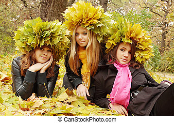 Three Beauties in a wreath