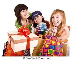 Three beautifu girlfriends enjoy shopping.