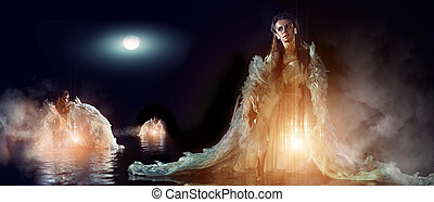 Three beautiful angels in the sea are bathing in the moon...