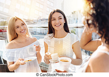 Three beautiful female friends greeting morning