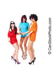 Three beautiful ladies dancing on white background