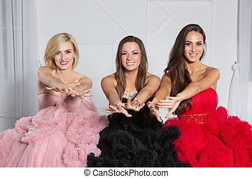 Three beautiful woman posing in the studio.