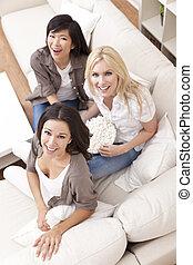 Three Beautiful Women Friends Eating Popcorn at Home