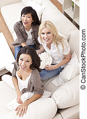 Three Beautiful Women Friends Eating Popcorn at Home
