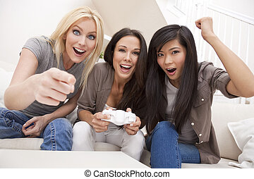 Three Beautiful Women Friends Playing Computer Games at Home
