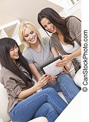 Three Beautiful Women Friends Using Tablet Computer