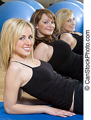 Three Beautiful Young Woman Aerobic Exercising At A Gym