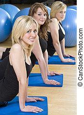 Three Beautiful Young Woman Aerobic Exercising At A Gym