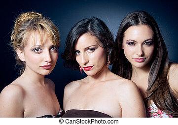 Three beautiful young woman