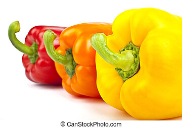Bell Peppers over a white background. - Three Bell Peppers...