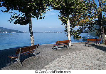 Three benches in front of the lake Annecy