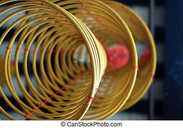 Three big incense coils