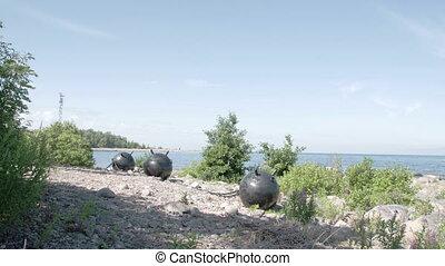 Three big sea mines found on the rocky shore of the sea....