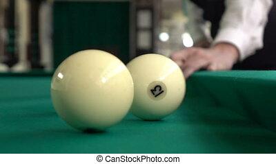 Three billiard balls moving in the frame