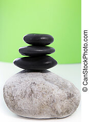 Three black stones stacked on top of each other