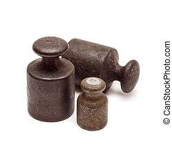 Three black weights - Set of three black antique calibration...