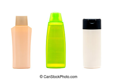 three blank cosmetic bottles on white