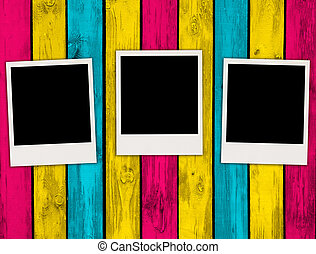 Three Blank Photos on Multicolored Wood Background