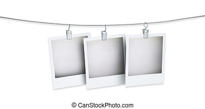 three blank  pictures hanging on a wire isolated on whit