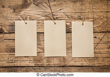 Three blank sheets for text with copy space on wooden background. Education and office concept.