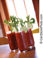 Three Bloody Mary Cocktail Drinks With High Depth of Field