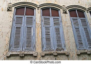 three blue old windows