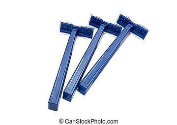 Three blue razors isolated on white background