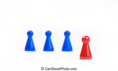 Three blurred blue game pieces as a team and one red sharpened figure as a leader in the foreground. Closeup photo with selective focus - isolated on white background