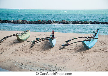 Three boats on beach Tangalle